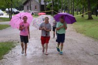 Campers prepare to take cover from the storm.